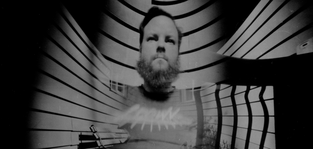 Self-portrait.  3 minute exposure in 3-pinhole camera.